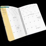 Open spiral-bound planner with days of month.