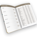 Open spiral-bound planner with days of week and reference page.