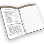 Open spiral-bound planner with reference page and notes.