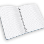 Open spiral-bound journal with grid pages.
