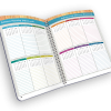 Open spiral-bound planner with monthly calendars.