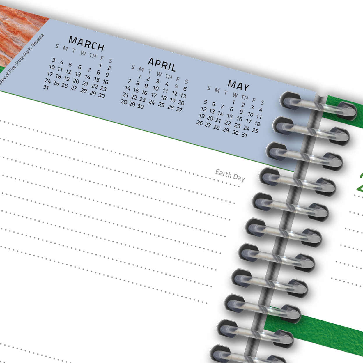 Close-up of lined planner page with calendar.