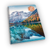 Spiral-bound planner with mountain, forest, and calm lake cover.