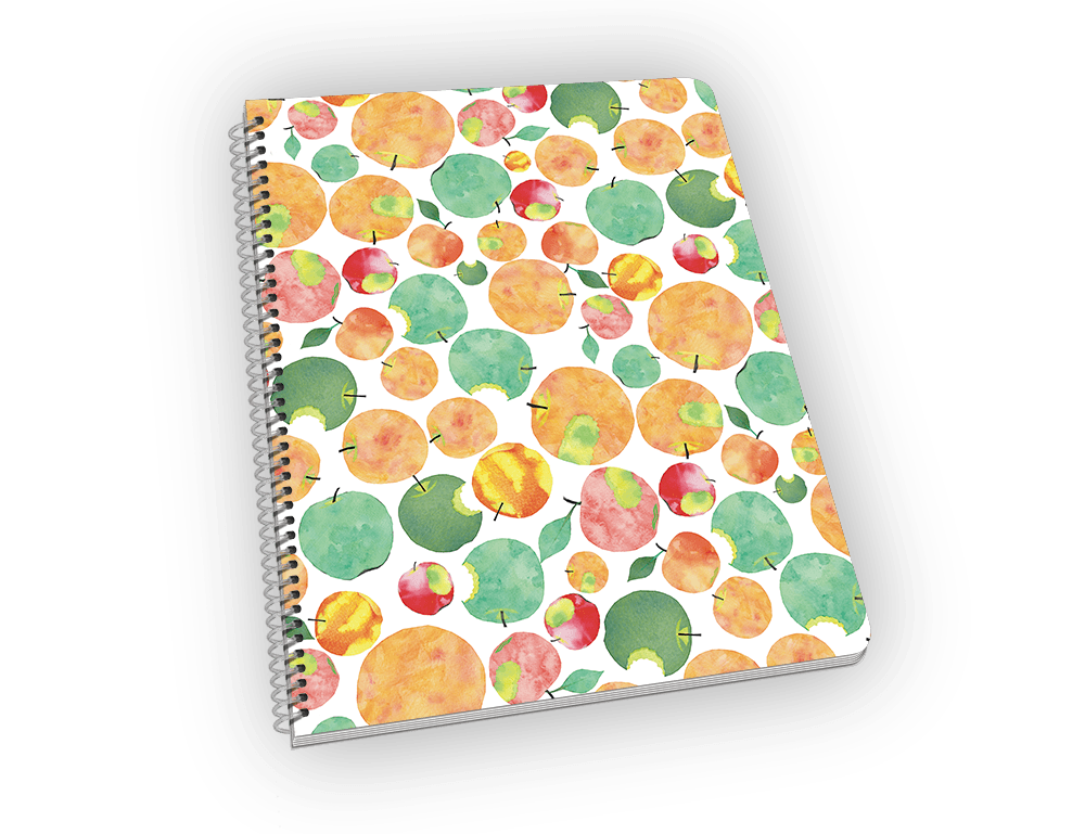 Spiral-bound notebook with apples on the cover.