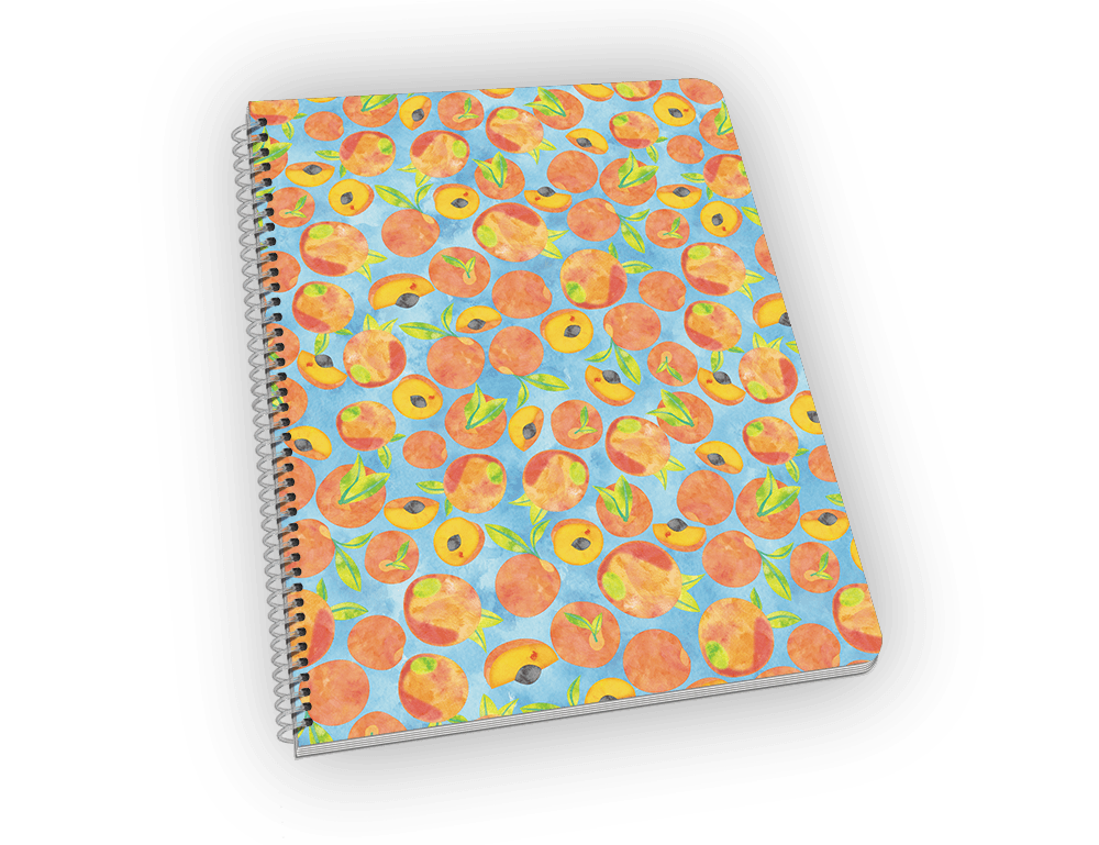 Spiral-bound notebook with peaches on the cover.
