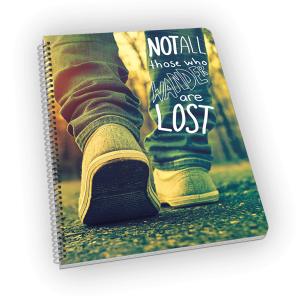 Spiral-bound notebook with sneakers and quote.