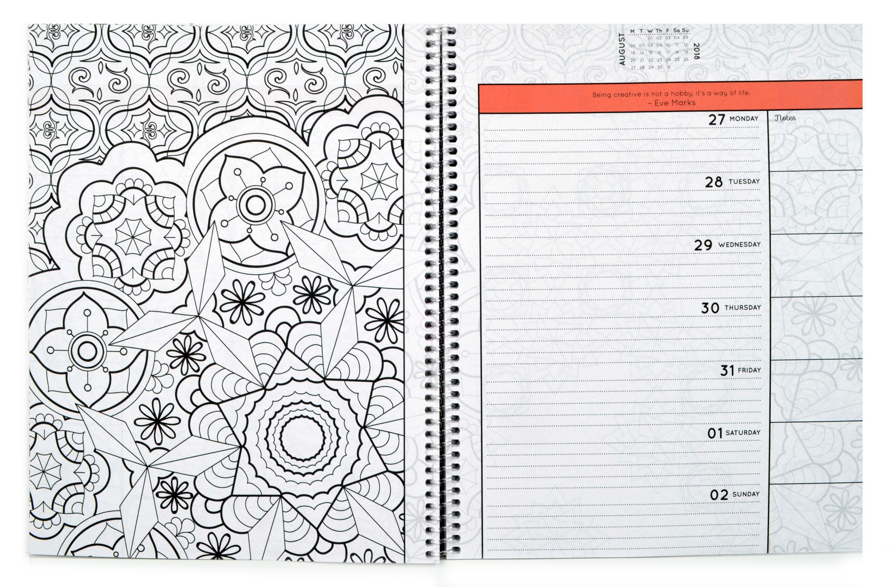 Open spiral-bound coloring planner with a geometric flower outline page.