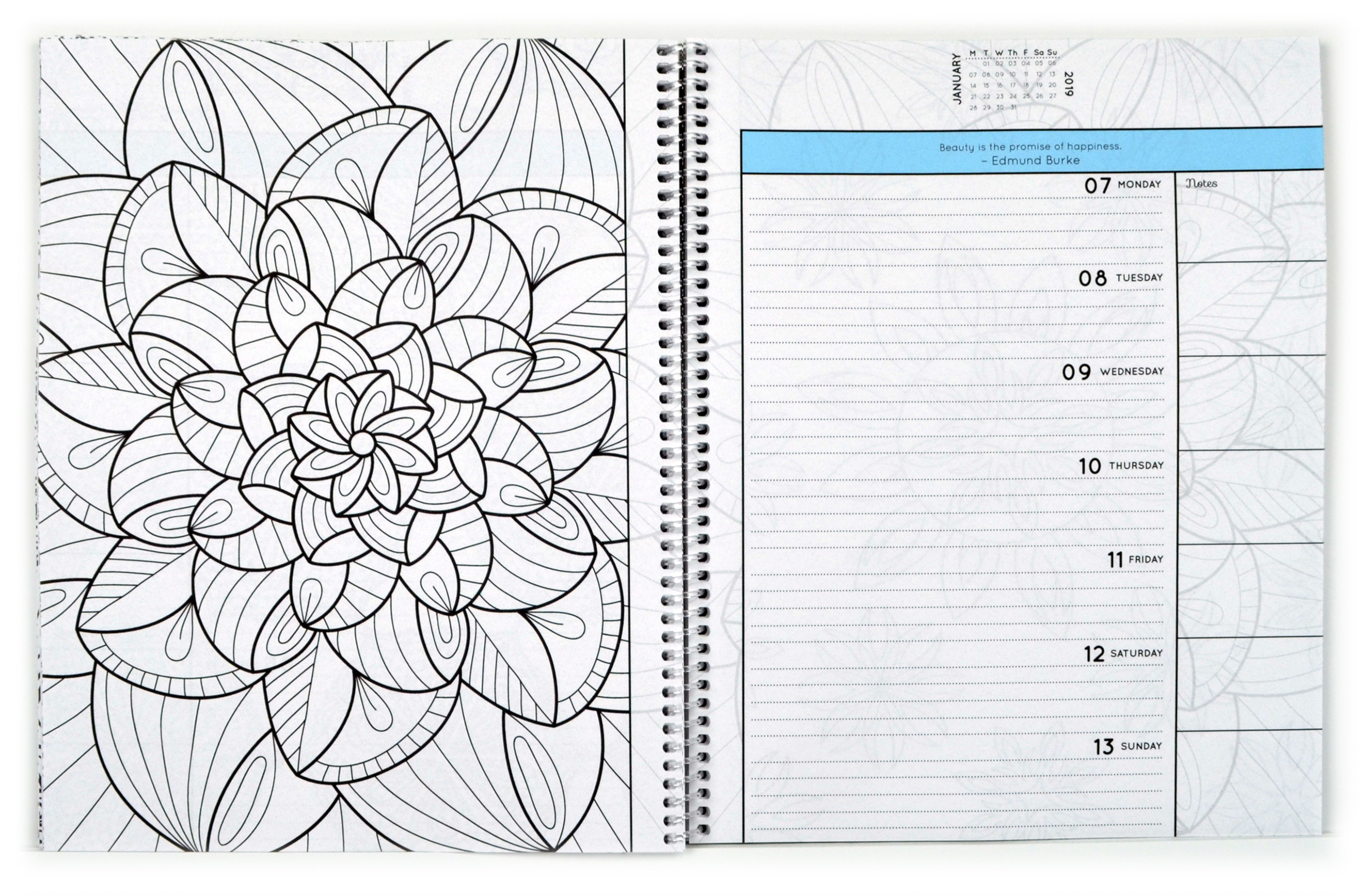 Open spiral-bound coloring planner with a flower outline page.