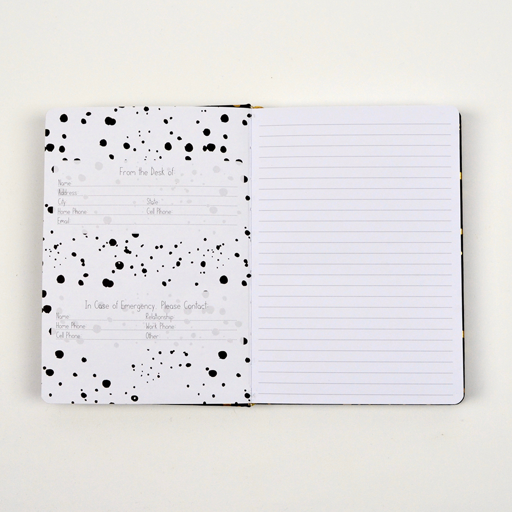 Open notebook with lined page and owner information.