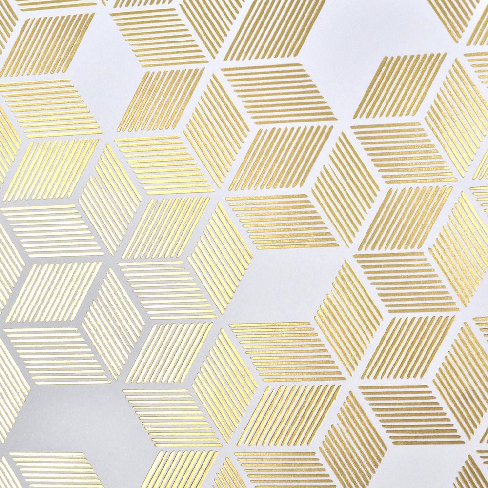 Close up of gold foil geometric pattern.