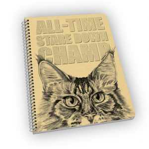 Spiral-bound notebook with cat and quote on the cover.